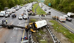 Emergency personnel examine a school bus after it collided with a dump truck, killing two people and injuring multiple people on Interstate 80 in Mount Olive, N.J., May 17, 2018.