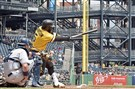 Pirates second baseman Josh Harrison hits a single against the Padres in the first inning May 20.