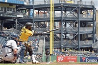 Pirates second baseman Josh Harrison hits a single against the Padres in the first inning Sunday, May 20, 2018 at PNC Park.
