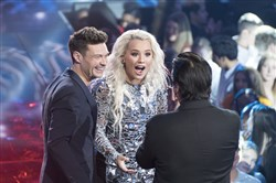 "Steve Perry of Journey fame surprises Pittsburgh's Gabby Barrett (with Ryan Seacrest) at the ""American Idol"" finale after she sang ""Don't Stop Believin'."""