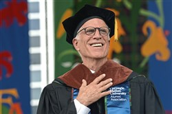 Actor Ted Danson, a Carnegie Mellon graduate, smiles after he is given the hood for his honorary doctorate at Carnegie Mellon University's commencement ceremony on Sunday.