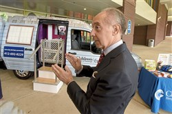 "Attorney John Gismondi  talks with Rachel Petrucelli, Interim President of the Children's Hospital of Pittsburgh Foundation, about the newly acquired ""Mobile Safety Center Van""  at the entrance of Children's Hospital of Pittsburgh of UPMC, Monday May 21, 2018 in the Lawrenceville section of Pittsburgh."
