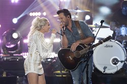 Gabby Barrett, of Munhall, sings with Luke Bryan during the Grand Finale of American Idol on Monday, May 21, 2018.