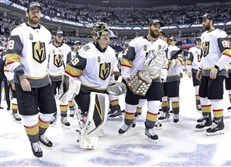 Left to right Vegas Golden Knights' James Neal, Deryk Engelland, goaltender Marc-Andre Fleury and the rest of the team celebrate after defeating the Winnipeg Jets during NHL Western Conference Finals, game 5, in Winnipeg, Sunday.