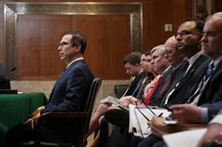 Treasury Secretary Steven Mnuchin, left, testifies before the Senate Appropriations Committee's Financial Services and General Government Subcommittee in the Dirksen Senate Office Building on Capitol Hill in Washington on May 22, 2018.