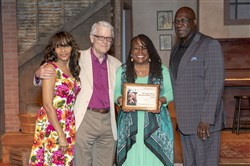 "The Ensemble Theatre in Houston receives the August Wilson American Century Cycle Award, co-sponsored by the Post-Gazette and the August Wilson House, on the set of ""Ma Rainey's Black Bottom."" From left: Ensemble executive director Janette L. Cosley; Post-Gazette senior theater critic Chris Rawson, who made the presentation; Eileen J. Morris, artistic director; and Jesse Tyson, president of the board of trustees."