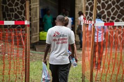 Doctors Without Borders team members walk through an Ebola security zone at the entrance of the Wangata Reference Hospital in Mbandaka, D.R. Congo, on May 20, 2018.