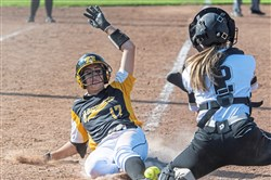 Thomas Jefferson's Paige Truax slides safely into home plate against Albert Gallatin for the game-winning run during the WPIAL Class 5A softball semifinal on Wednesday at Boyce Mayview Park. Thomas Jefferson beat Albert Gallatin 2-0 in 8 innings. (Steph Chambers/Post-Gazette)