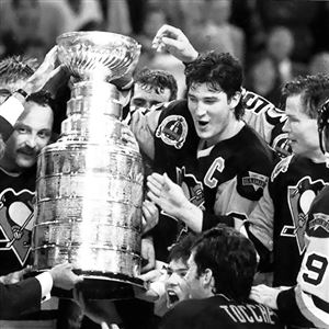 Penguins photothe cup changes everything Bryan Trottier and Mario Lemieux and the 1992 Penguins celebrate with the Stanley Cup after defeating the Chicago Blackhawks.