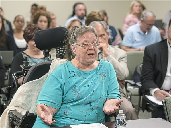 Gayle Lewandowski of Bellevue describes difficulty she's had receiving transportation services during public discussion of Pennsylvania's new Community HealthChoices program.