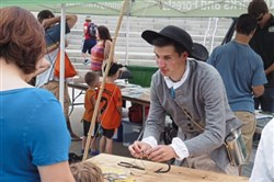 Ross Martin, a former intern at the Fort Pitt Museum, demonstrates how to tie a hook on a line at the museum's Free Family Fishing Day in 2016.