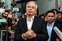 Malaysia's former prime minister Najib Razak speaks to the media after being questioned at the Malaysian Anti-Corruption Commission office in Putrajaya on May 24, 2018.