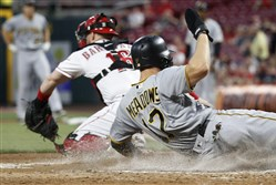 Pittsburgh Pirates' Austin Meadows scores on a bunt single by Chad Kuhl Wednesday.