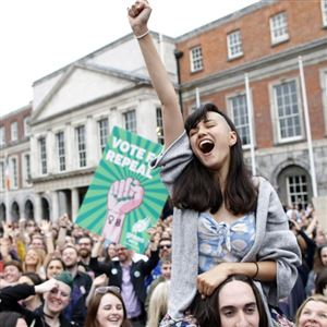 "A woman from the""Yes"" campaign reacts after the final result was announced, after the Irish referendum on the 8th Amendment of the Irish Constitution at Dublin Castle, in Dublin, Ireland, Saturday."