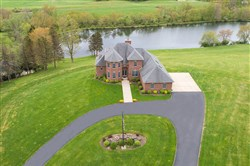 The house at 123 Harjer Lane in Adams Township with the private lake behind.
