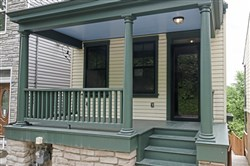 The front porch of the house in the North Side's East Deutschtown neighborhood has three original columns.