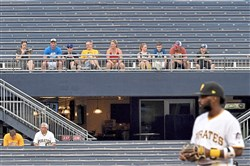 Pirates second baseman Josh Harrison takes the field as fans watch from the outifeld bleachers as team takes on the Cubs Tuesday, May 29, 2018 at PNC Park. (Matt Freed/Post-Gazette)