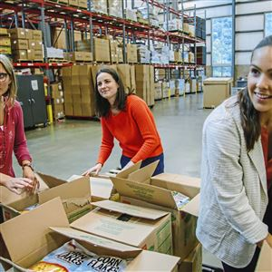 Erin Spangler, Erin Kelly and Kelsey Eckenroth, Health and Wellness Team members with the Greater Pittsburgh Community Food Bank, prepare food for medically tailored food boxes Tuesday in Duquesne.