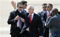 Vice President Mike Pence waves after arriving at Dallas Love Field in Dallas on Wednesday, June 13, 2018 to speak at the annual meeting of the Southern Baptist Convention.