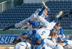 Bodies go flying as Canon-McMillan baseball players celebrate their win against Bensalem during the PIAA Class 6A baseball championship on Friday, June 15, 2018, at Medlar Field at Lubrano Park at Penn State University in State College. Canon-McMillan beat Bensalem, 10-3
