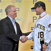 Pirates general manager Neal Huntington congratulates first-round draft pick Travis Swaggerty during a press conference after he signed with the team Friday, June 15, 2018 at PNC Park.