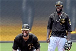 Pirates utility player Sean Rodriguez and second baseman Josh Harrison go through drills during batting practice Saturday, June 16, 2018 at PNC Park.