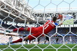 Iceland goalkeeper Hannes Halldorsson makes a diving save on a penalty kick by Argentina's Lionel Messi, helping preserve a 1-1 draw in their Group D opener Saturday in Moscow.