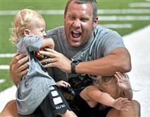 Steelers quarterback Ben Roethlisberger gets a Father's Day hug from his son, Bodie, 2, as his daughter, Baylee, 4, takes cover during his Pro Camp Sunday, June 17, 2018, at UPMC Rooney Sports Complex.