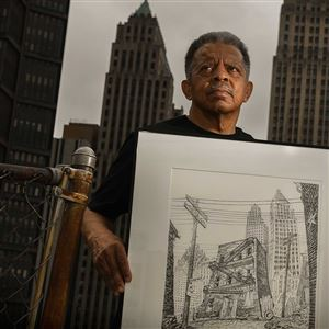 Carlos Peterson holds a sketch he drew of the Clay Way building that was his family's last home in the Lower Hill District. Looming above the neighborhood in the sketch and behind Peterson are the Koppers Building and Gulf Tower.