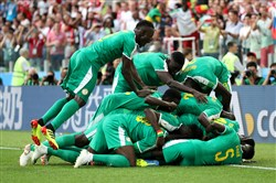 Mbaye Niang of Senegal celebrates after scoring his team's second goal with teammates during the 2018 FIFA World Cup Russia group H match between Poland and Senegal at Spartak Stadium on June 19, 2018 in Moscow.