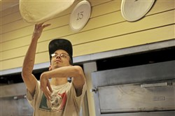 Dan Reno from Pitcairn tosses pizza dough at Vincent's Pizza on Wednesday in Forest Hills.