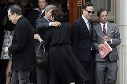 Andy Spade, right, leaves his wife's service at Our Lady of Perpetual Help Catholic Church in Kansas City, Mo., on June 21, 2018.