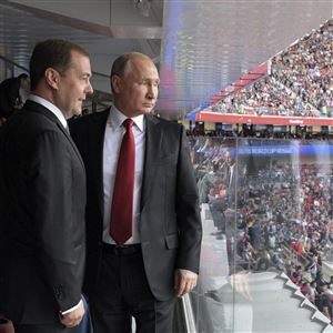 Russian President Vladimir Putin, right, and Russian Prime Minister Dmitry Medvedev look at the field during the match between Russia and Saudi Arabia that opened the World Cup last week.