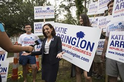 In this June 12, 2018 file photo, South Carolina Rep. Katie Arrington, who is running for the first district of South Carolina, campaigns after voting for herself in the primary election at Bethany United Methodist Church in Summerville.