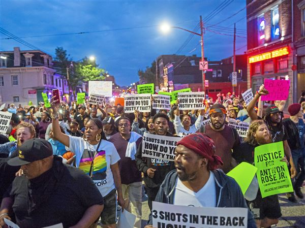 Demonstrators march through East Carson Street on Saturday, June 23, 2018, in the South Side. Demonstrators took to the streets of Pittsburgh to demonstrate for the fourth day in a row following the shooting death of 17-year-old Antwon Rose II.
