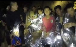 In this July 3, 2018, file image taken from video provided by a Thai Navy SEAL, Thai boys are with Navy SEALs inside a cave in Mae Sai, northern Thailand.