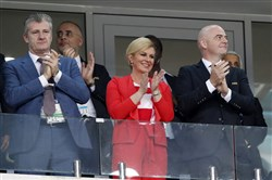 Croatia's President Kolinda Grabar-Kitarovic, center, applauds prior the quarterfinal match between Russia and Croatia at the 2018 soccer World Cup in Fisht Stadium in Sochi, Russia, on July 7, 2018.