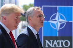 President Donald Trump, left, walks with NATO Secretary General Jens Stoltenberg as he arrives to attend the NATO summit in Brussels on July 11, 2018.