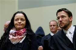 Lawyer Mathias Grasel, right, and defendant Beate Zschaepe wait in a courtroom in Munich, Germany, on July 11, 2018, before the proclamation of sentence in her trial as the only surviving member of the National Socialist Underground cell behind a string of neo-Nazi, racist murders.