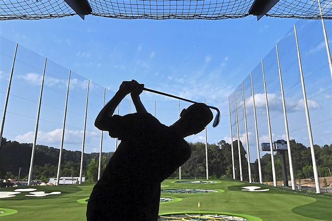 Pittsburgh Penguins Matt Murray hits off the tee during the preview event at Topgolf entertainment complex in South Fayette on Wednesday.