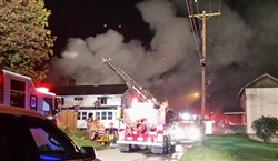 Firefighters battle a two-alarm fire at a duplex in Crescent early Monday morning.