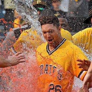 Adam Frazier is doused after hitting a walk-off home run in the 11th inning Sunday, Aug. 19, 2018, against the Chicago Cubs at PNC Park.