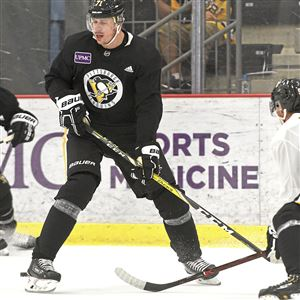 Penguins forward Evgeni Malkin (center) and Phil Kessel (left) work against Ryan Haggerty (right) during a drill on the third day of Penguins training camp at the UPMC Lemieux Sports Complex in Cranberry on Sept. 16, 2018.