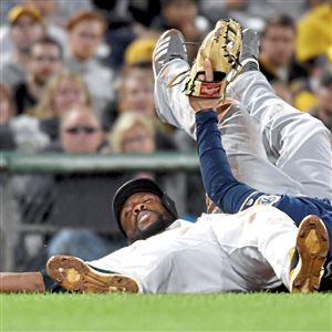 Brewers third baseman Mike Moustakas gets Pirates center fielder Starling Marte out on a steal attempt at third base in the first inning Saturday, Sept. 22, 2018 at PNC Park.