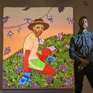 "Devan Shimoyama with his 2018 work ""Weed Picker"" at The Andy Warhol Museum on the North Side."