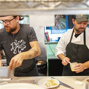 Bar Marco employees John DeMarco, left, and Dan Lamb work in the kitchen on Thursday in the Strip District. Bar Marco offers two weeks of paid time off to its employees, that can be taken as sick leave or vacation.