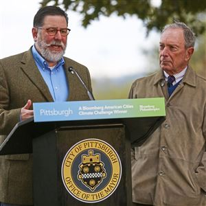 Pittsburgh Mayor William Peduto, left, speaks with former New York Mayor Michael Bloomberg, right, during a press conference announcing that Pittsburgh is a Bloomberg American Cities Climate Challenge winner Sunday Oct. 21, 2018, at West End-Elliott Overlook Park in Elliott.
