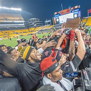 The Aliquippa football team hoists their trophy after beating Derry Area in the WPIAL Class 3A championship game, Saturday, Nov. 17, 2018, at Heinz Field.