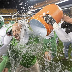 South Fayette head coach Joe Rossi is doused with water after they beat Thomas Jefferson, 31-24, during the WPIAL Class 4A championship on Saturday, Nov. 17, 2018, at Heinz Field.