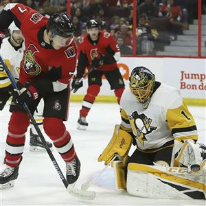 Ottawa Senators left wing Brady Tkachuk tries to tip in the puck against Pittsburgh Penguins goaltender Casey DeSmith during second-period NHL hockey game action in Ottawa, Ontario, Saturday, Nov. 17, 2018.